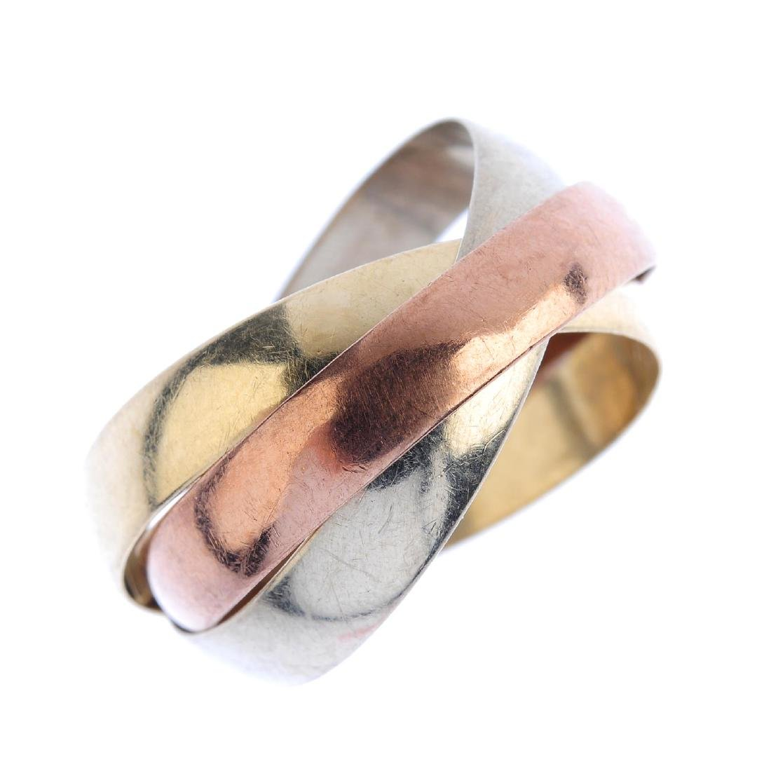 A 9ct gold band ring. Of tri-colour design, comprising