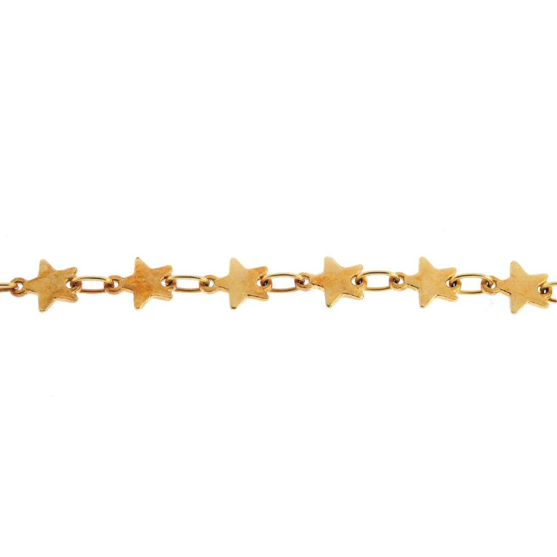 A bracelet. Comprising a series of stars, with