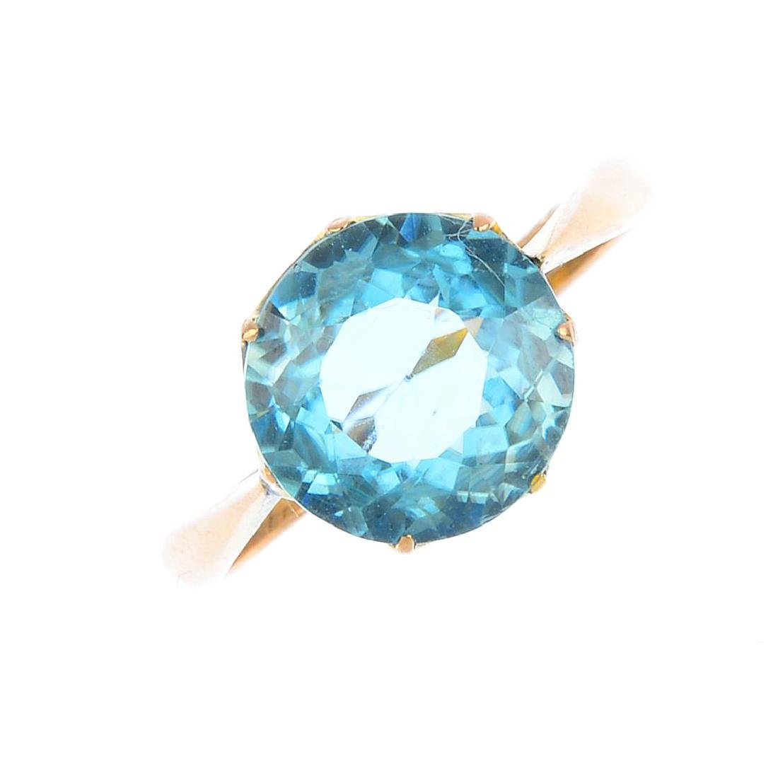 A zircon single-stone ring. The circular-shape blue