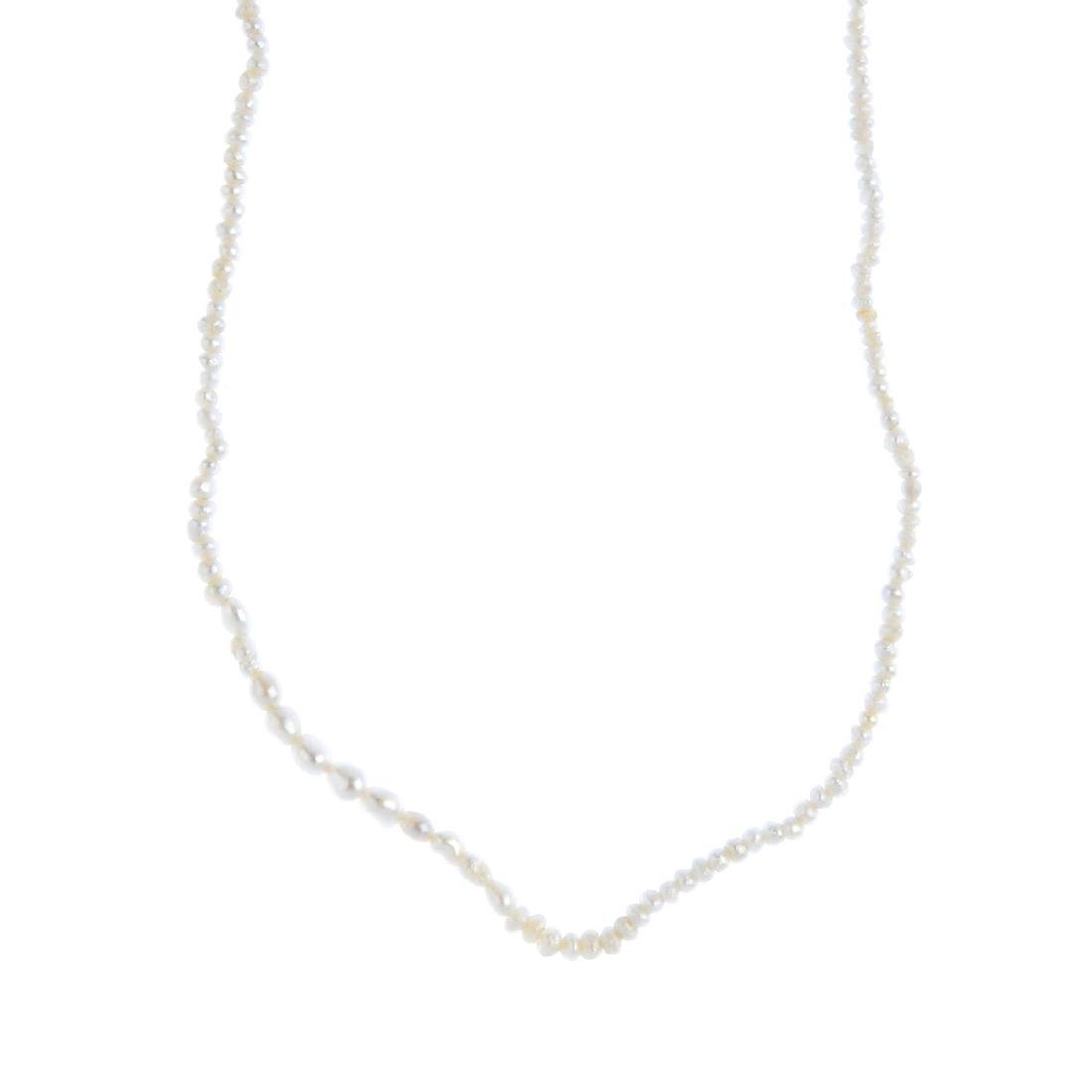 A seed pearl single-strand necklace. Comprising a