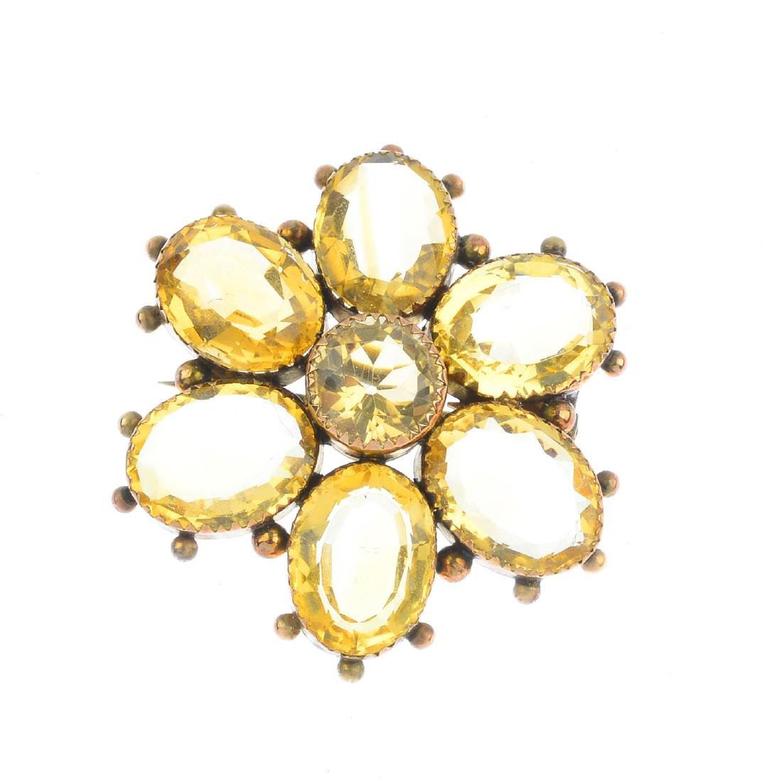 A late Victorian citrine brooch. The circular-shape