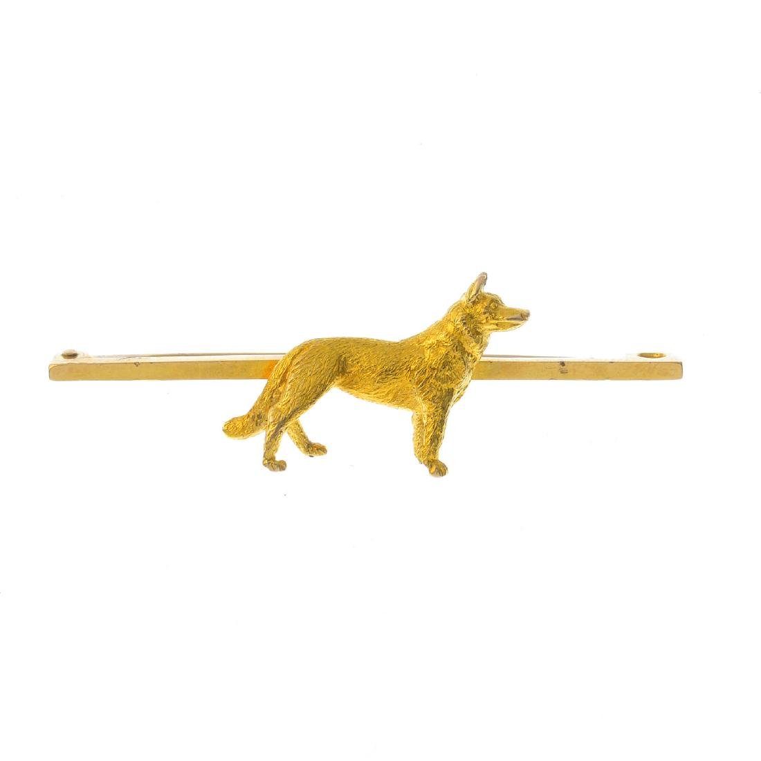 A dog bar brooch. Design as a textured dog. atop a