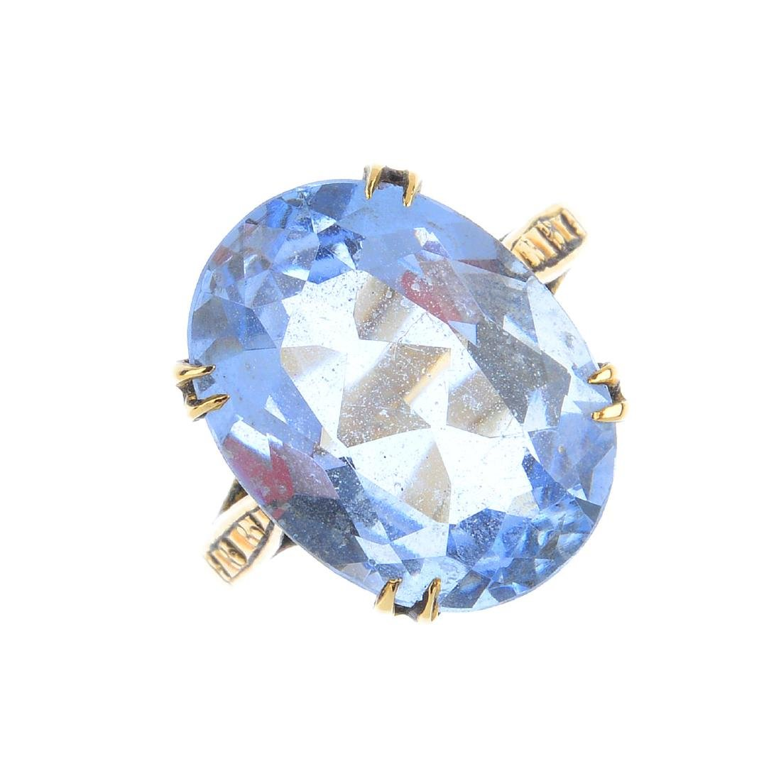 A synthetic spinel dress ring. The oval-shape synthetic