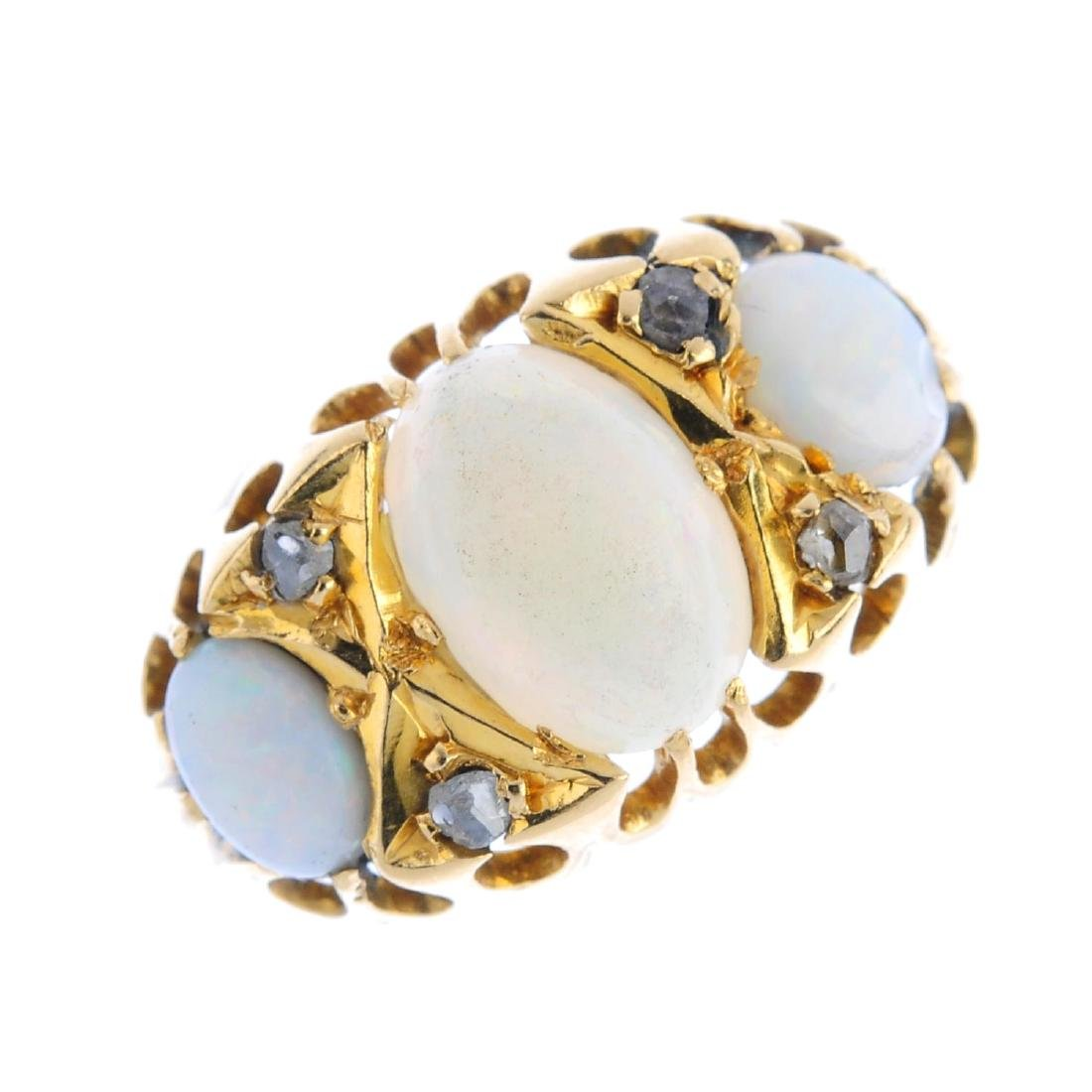 An Edwardian 18ct gold opal and diamond ring. The oval