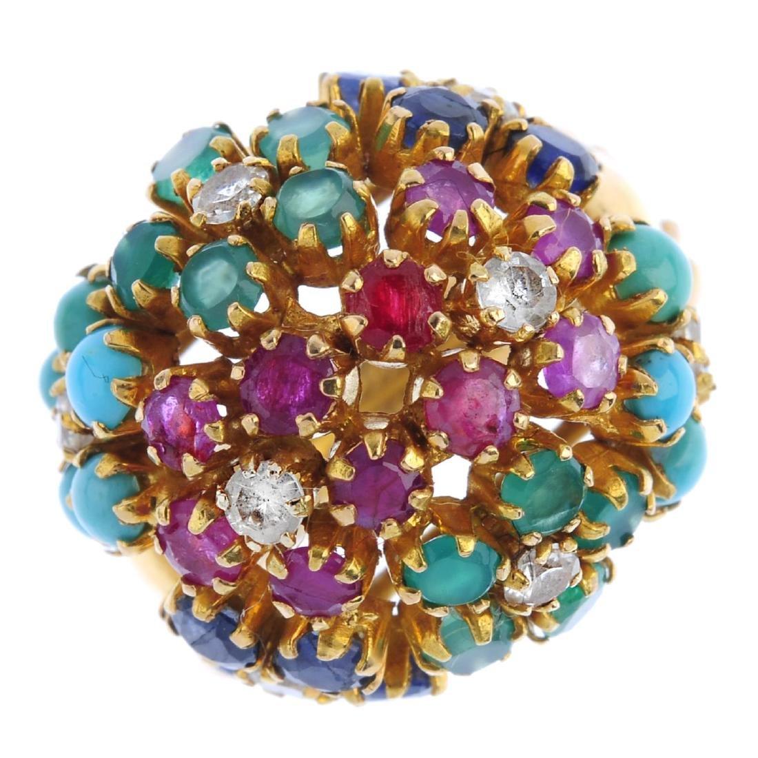 A vari-gem set ring. Of bombe design, comprising