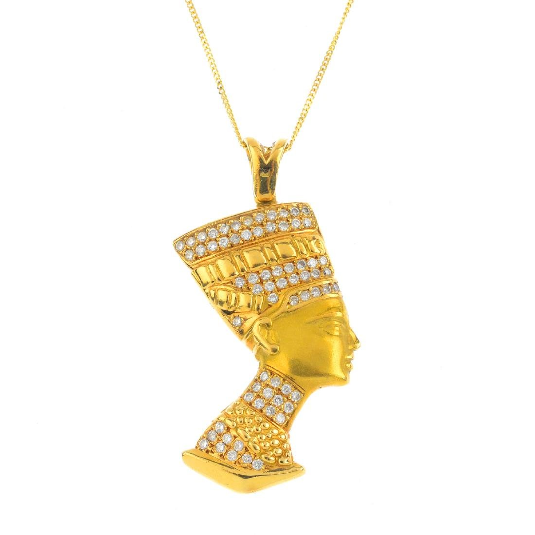 A diamond pendant. Designed to depict a pharaoh in