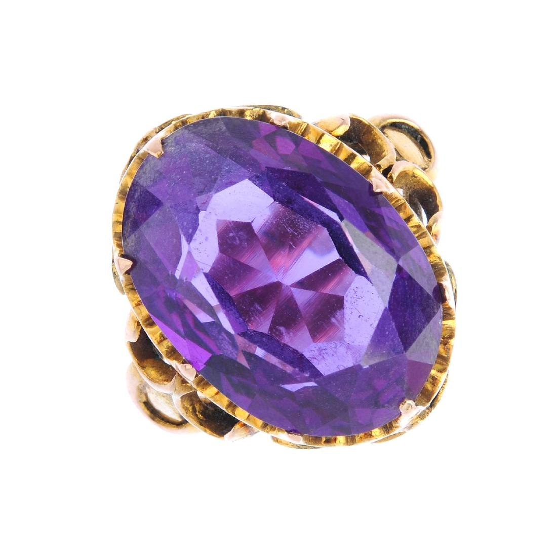 Four gem-set rings. To include a 9ct gold ruby and