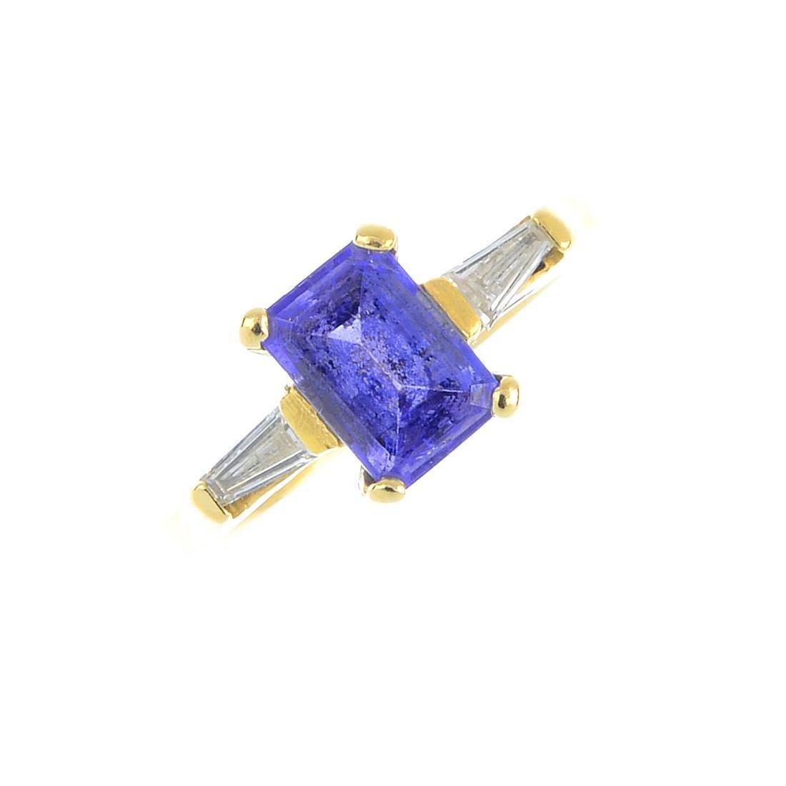 A tanzanite and diamond ring. The rectangular-shape