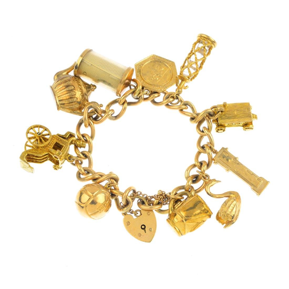 A mid 20th century 9ct gold charm bracelet. The
