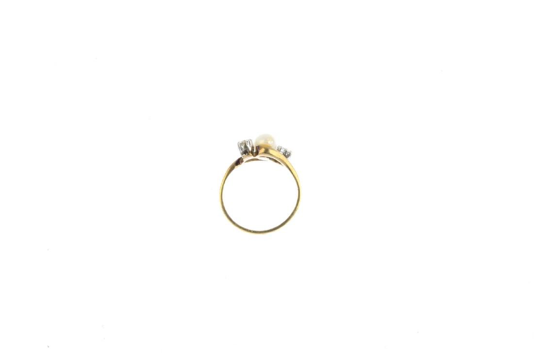 A cultured pearl and diamond ring. The cultured pearl, - 2