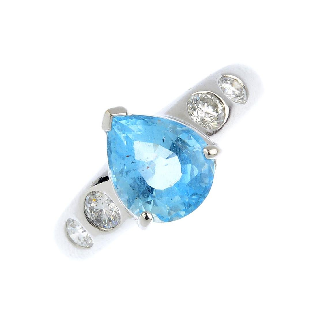 An aquamarine and diamond single-stone ring. The
