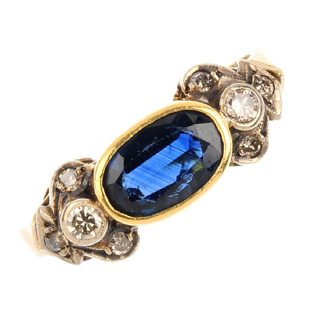 A sapphire and diamond ring. The oval-shape sapphire,