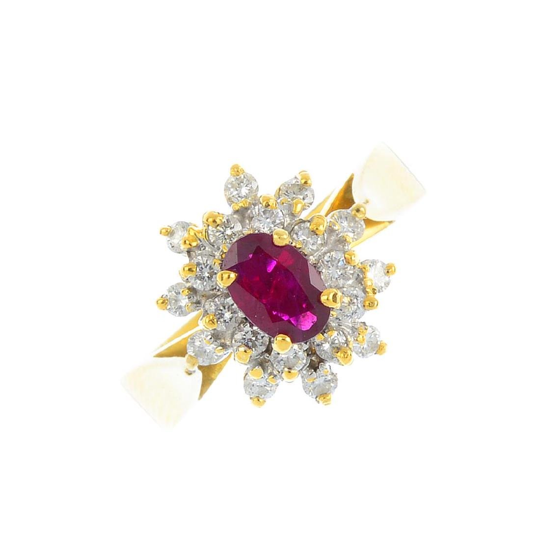 A ruby and diamond cluster ring. The oval-shape ruby,