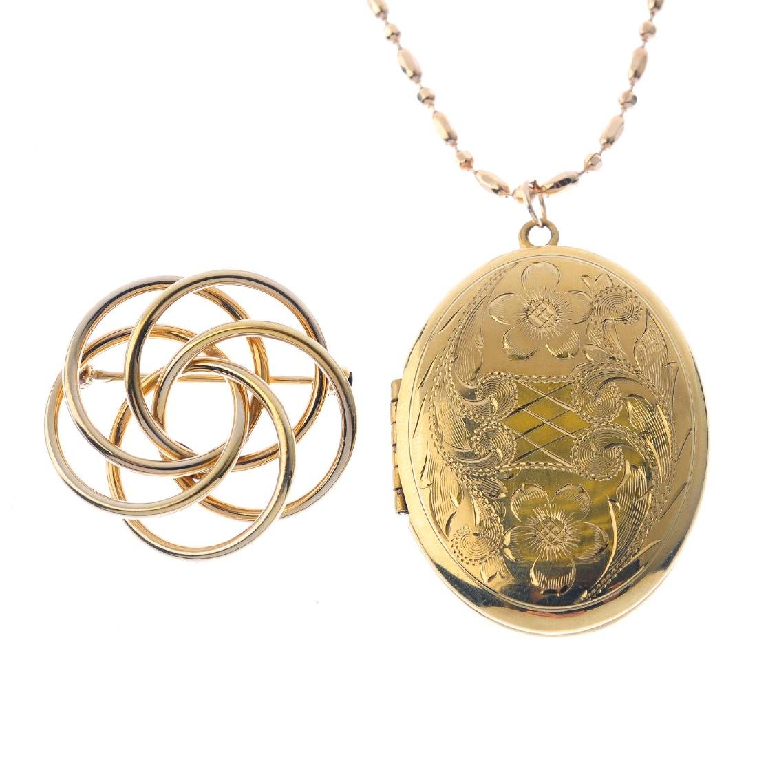 A locket and a brooch. To include an oval-shape floral