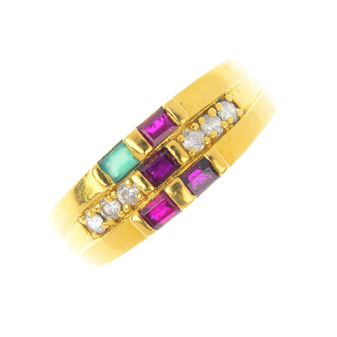 A gem-set dress ring. The baguette-cut ruby and emerald