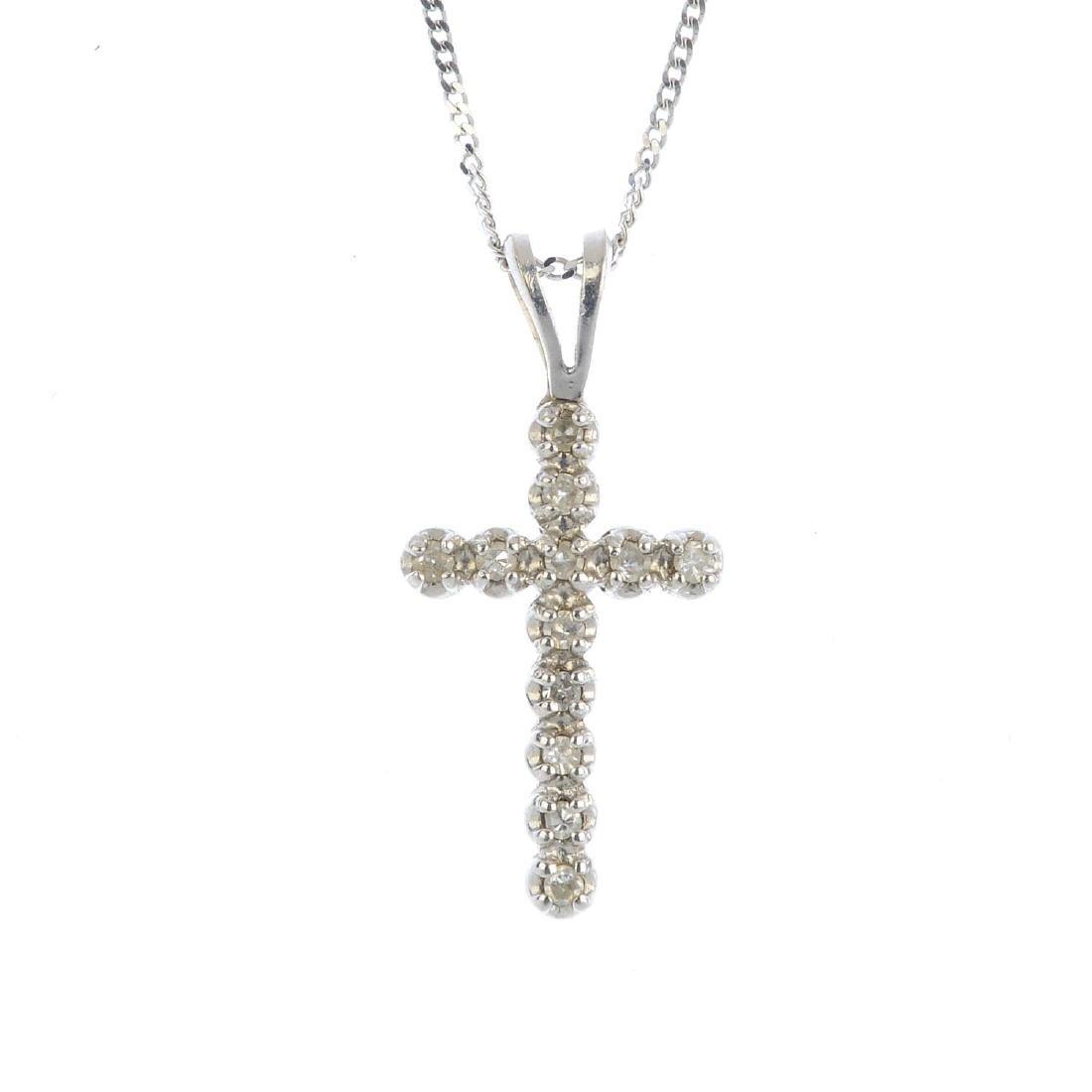 A diamond cross pendant. The single-cut diamond