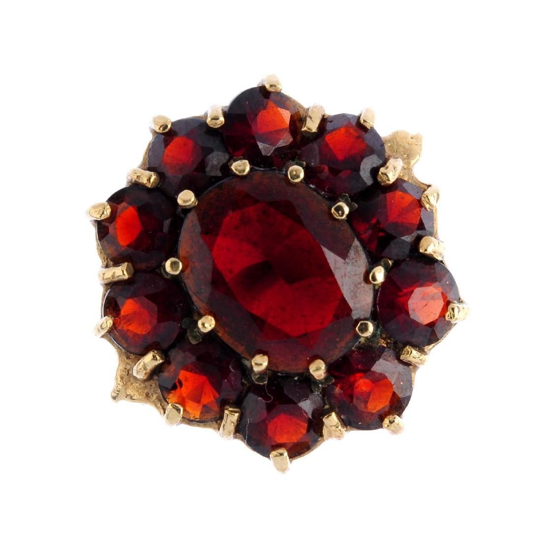 Four gem-set rings. To include a 9ct gold garnet
