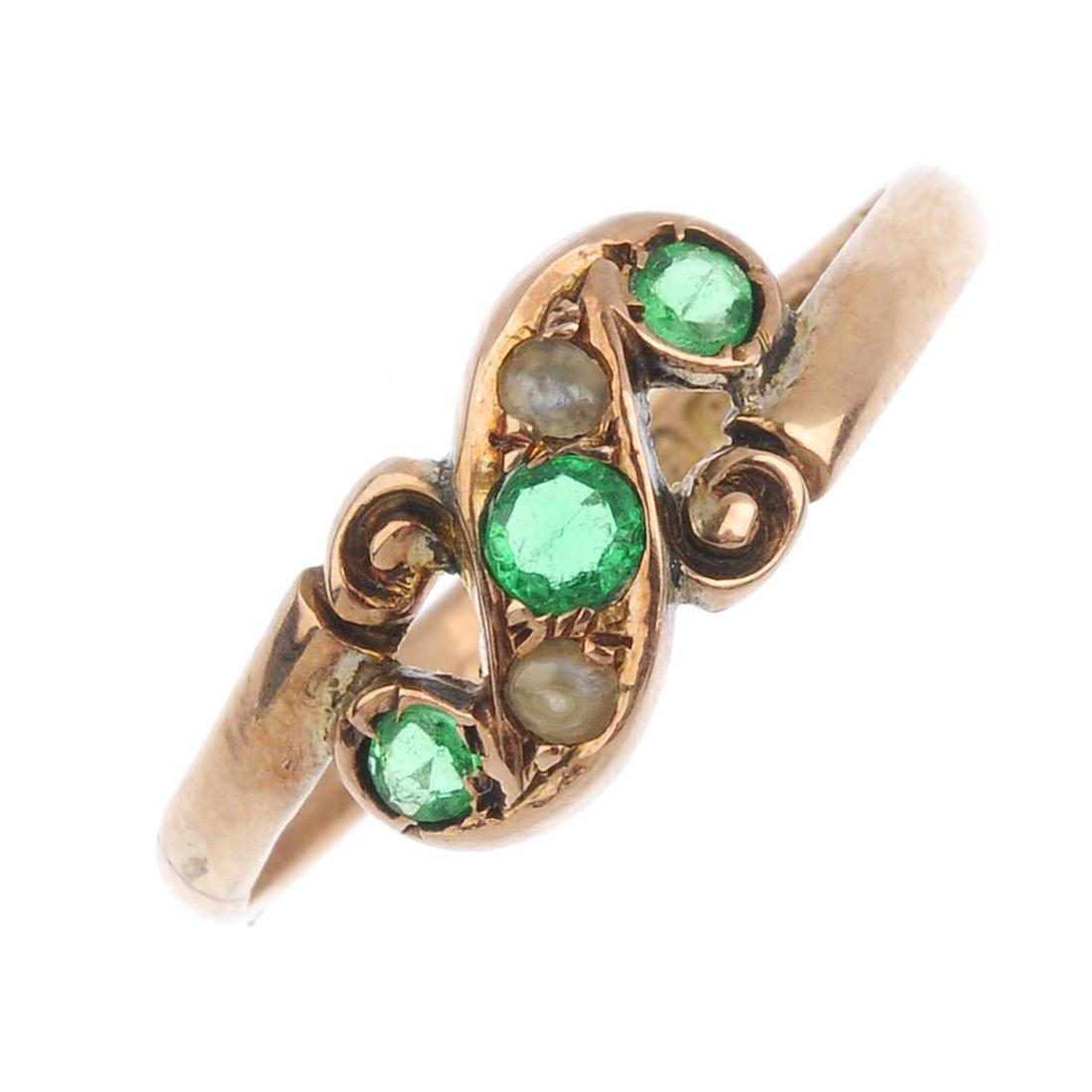 An Edwardian 9ct gold gem-set ring. The circular-shape