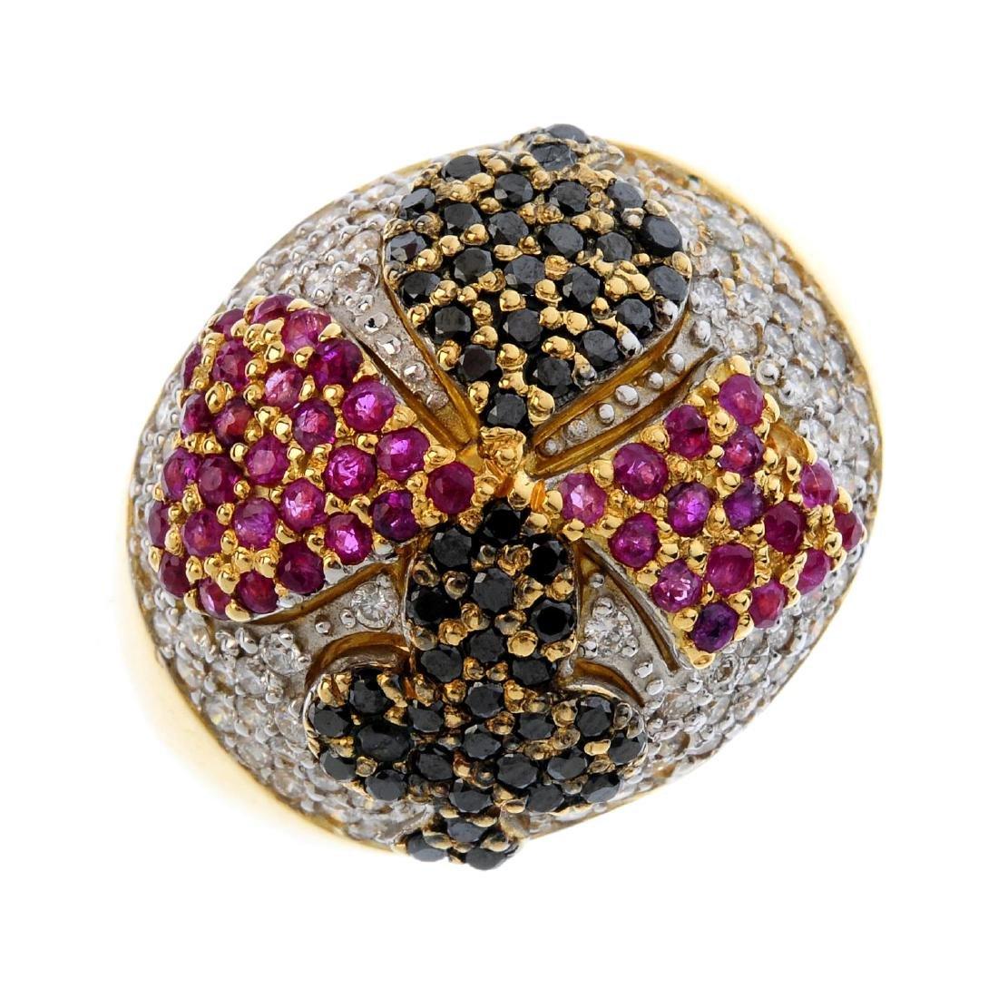 A diamond and gem-set ring. The pave-set diamond dome,