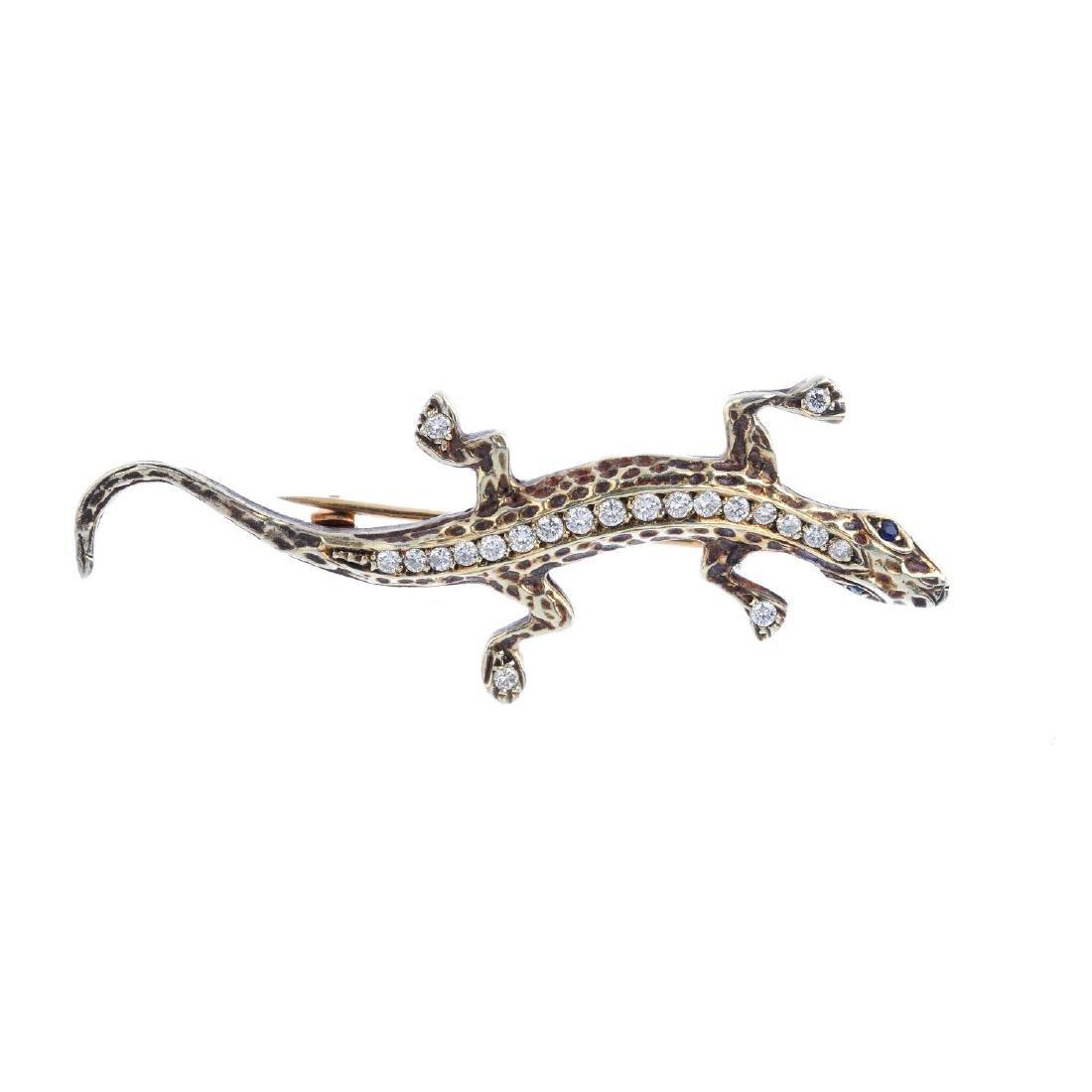 A 9ct gold diamond and sapphire salamander brooch.