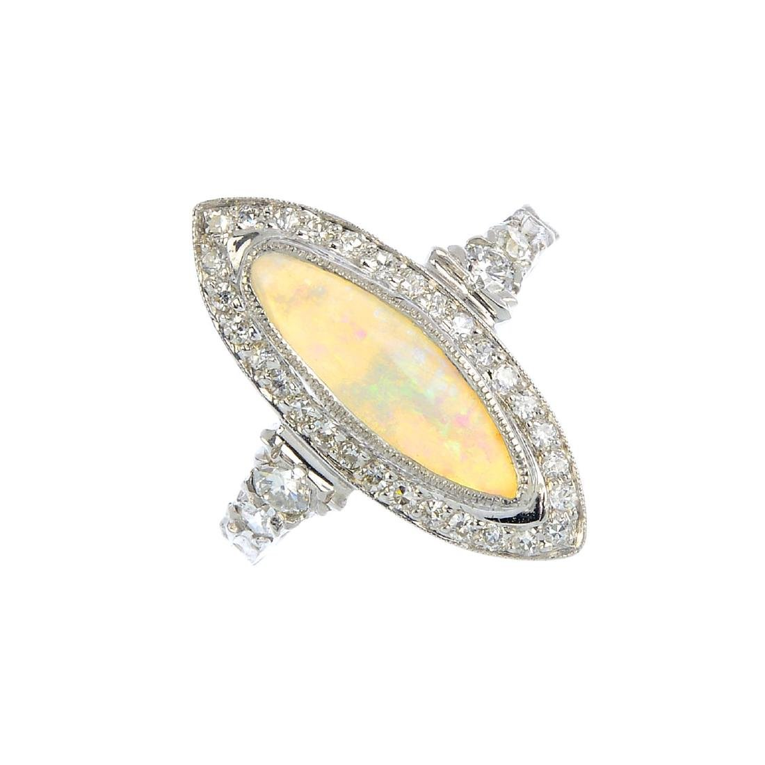 An opal and diamond cluster ring. The marquise opal