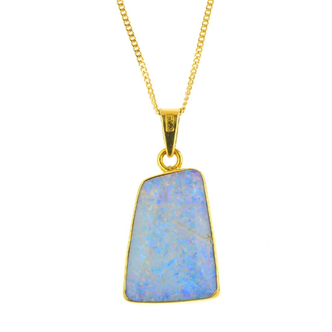 An opal pendant. The tapered rectangular opal cabochon,