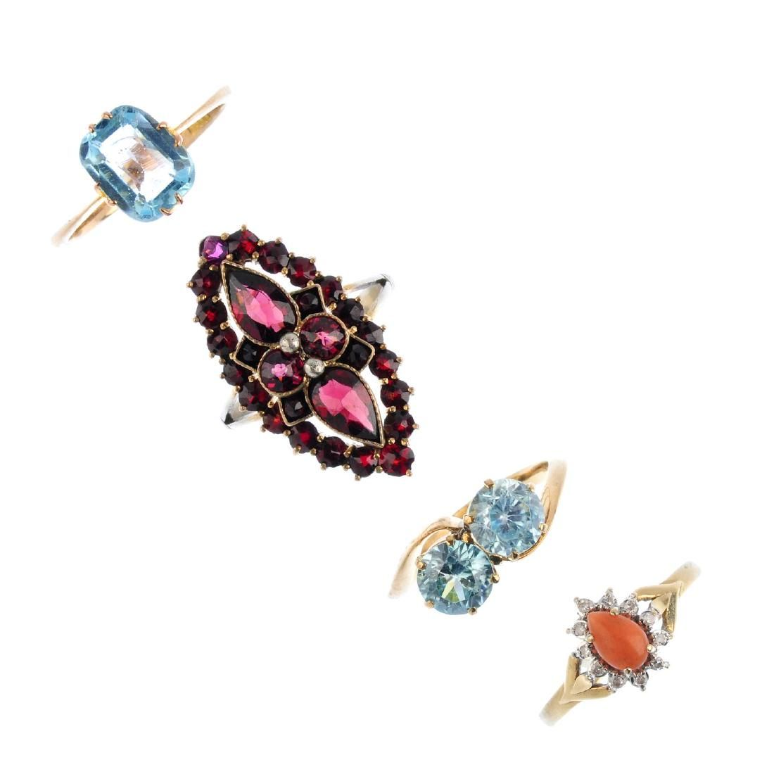 Four gem-set rings. To include a 9ct gold coral and