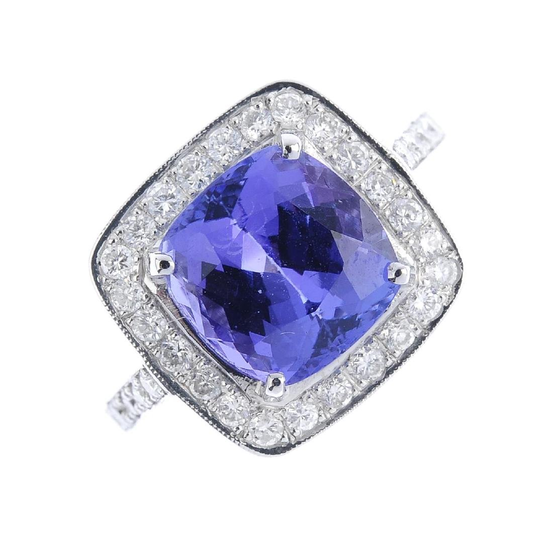 A tanzanite and diamond cluster ring. The cushion-shape