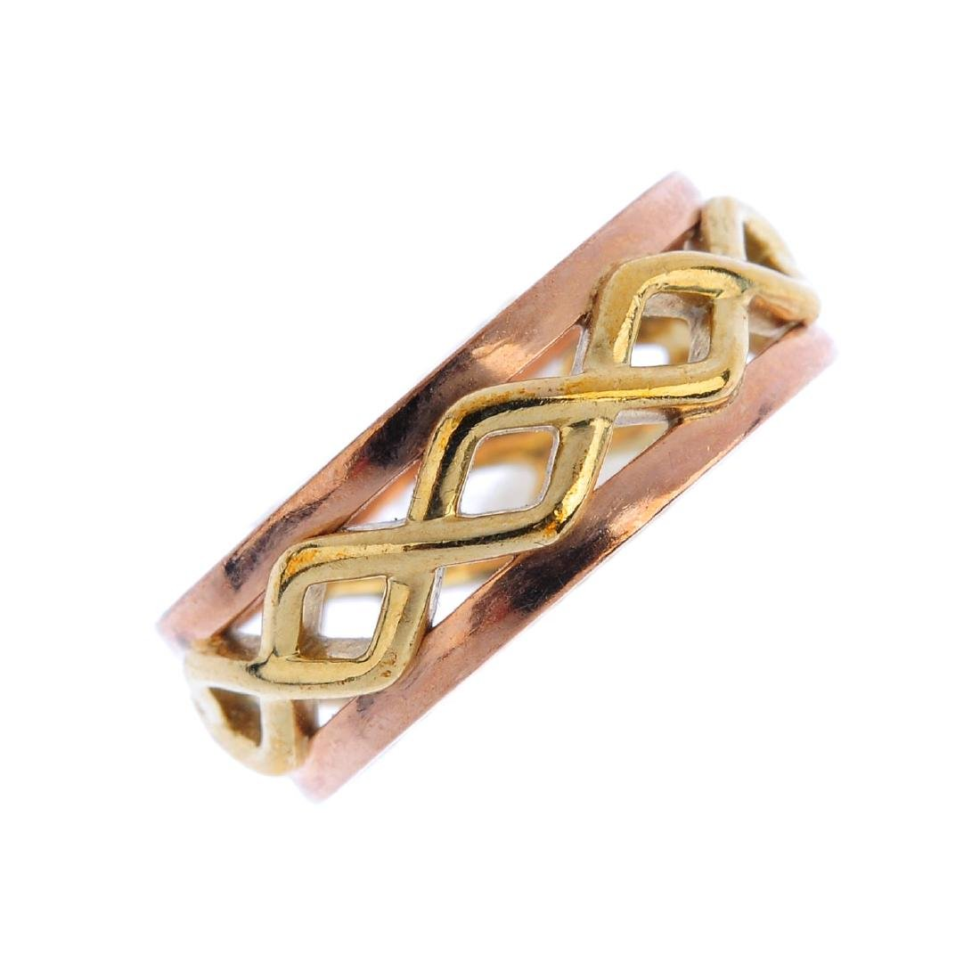 CLOGAU - a 9ct gold band ring. Of bi-colour design, the