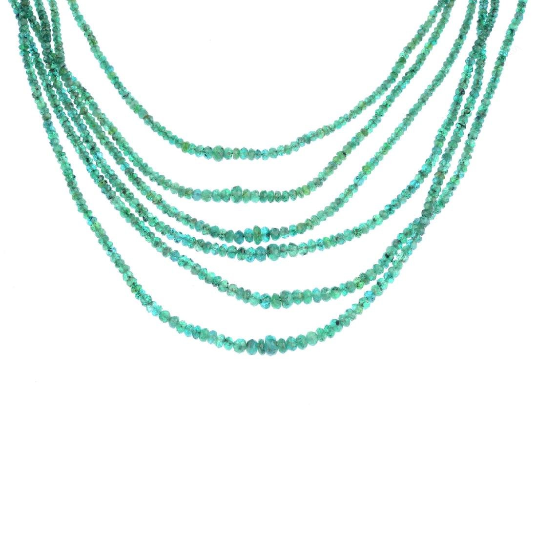 An emerald necklace. Comprising six strands of