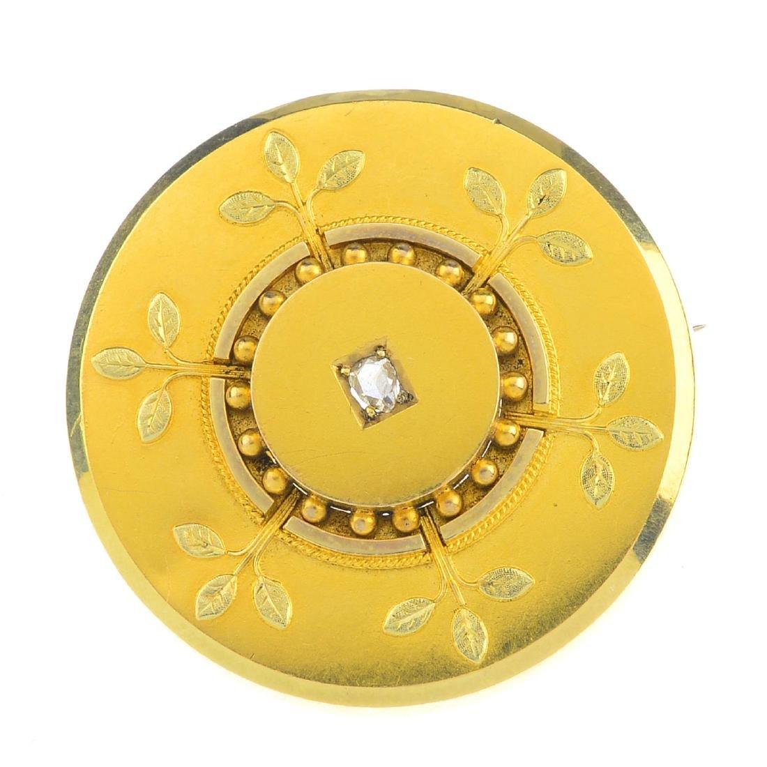 A late Victorian diamond memorial brooch. Of circular