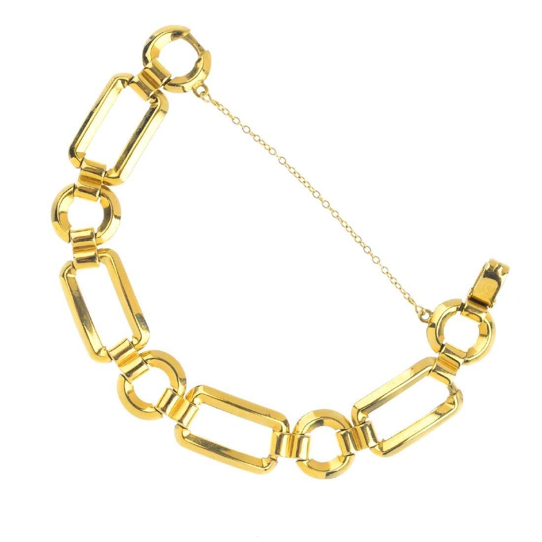 A bracelet. Of openwork design, the alternating series