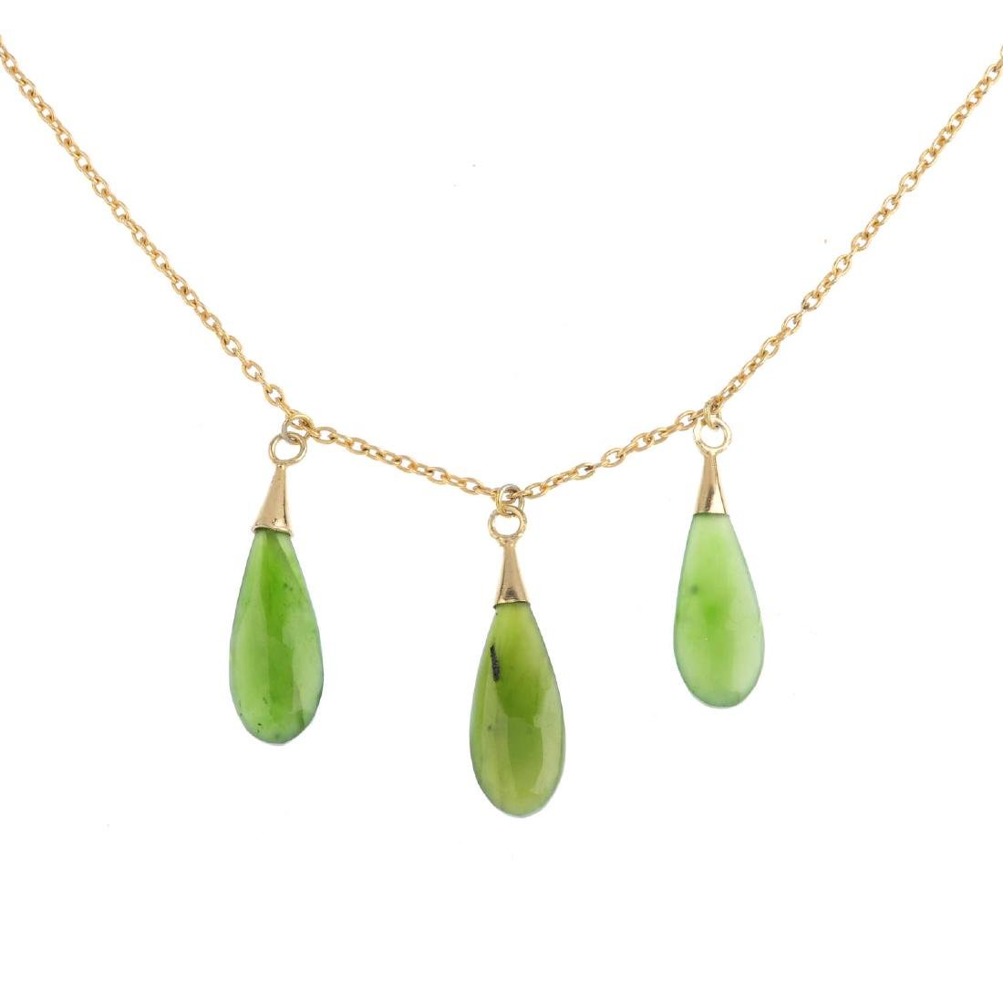 A jade necklace. Designed as three pear-shape nephrite