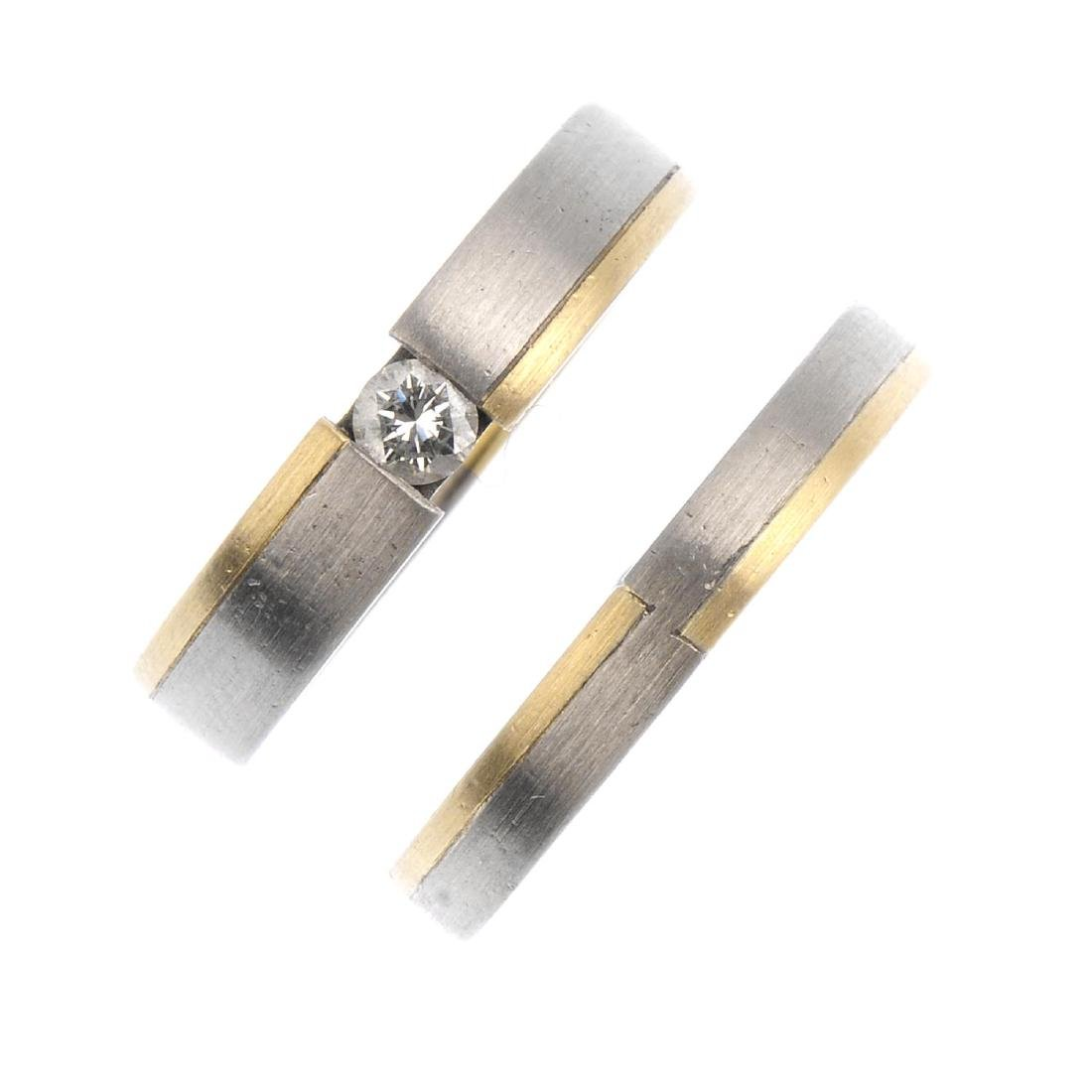 A set of two 18ct gold rings. Each of bi-colour design