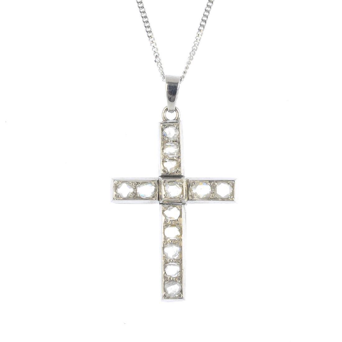 A diamond cross pendant. The rose-cut diamond cross,