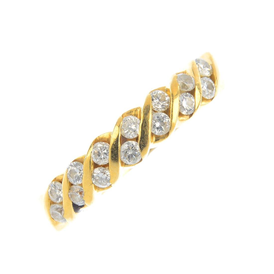 A diamond dress ring. Designed as a series of