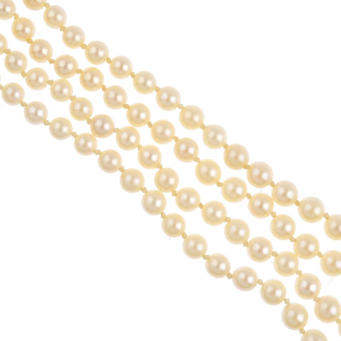 A cultured pearl two-row necklace. Comprising two rows