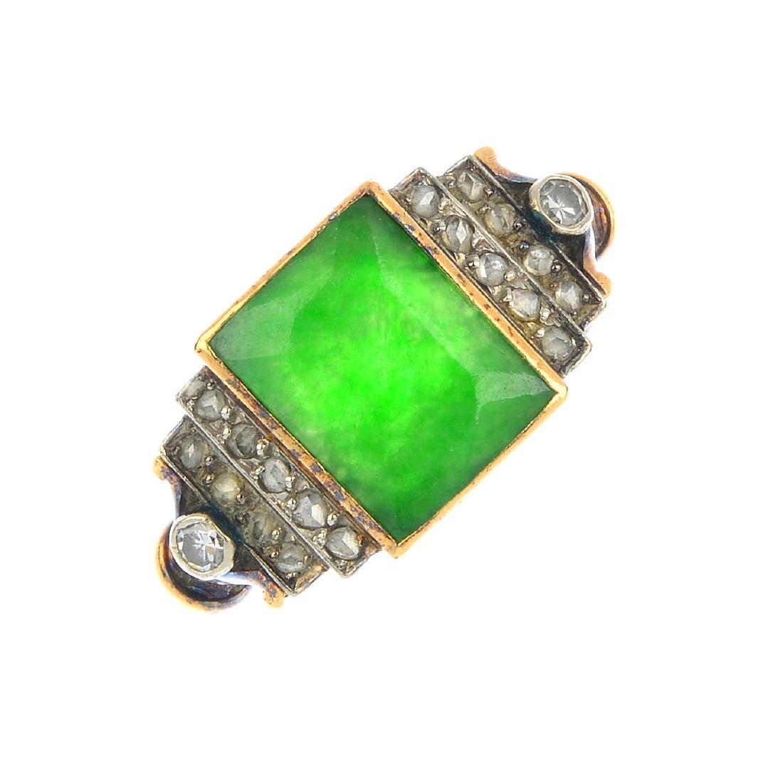 A jade and diamond dress ring. The rectangular jade