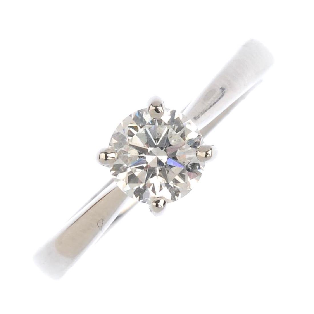 A platinum diamond single-stone ring. The brilliant-cut