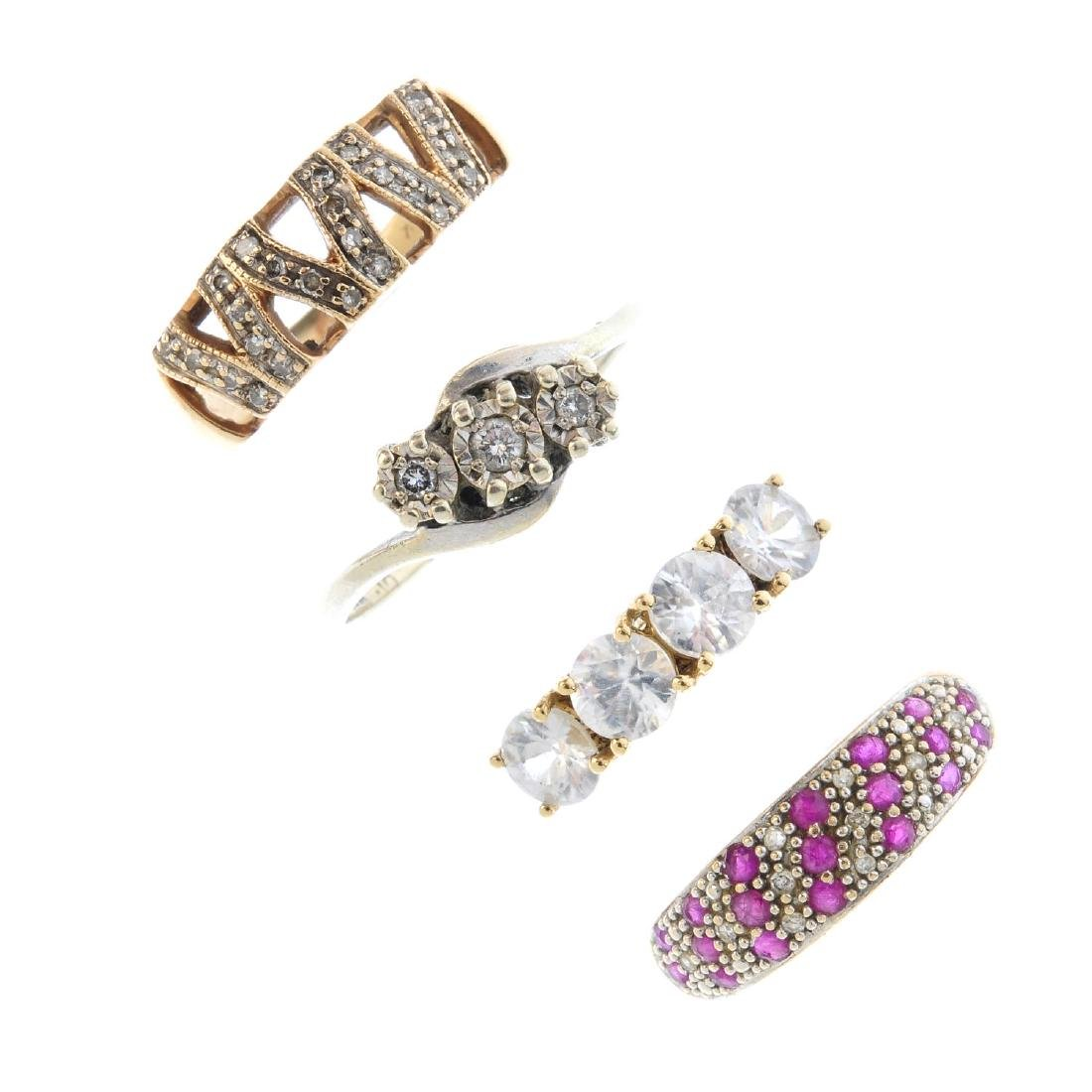 Four diamond and gem set rings. To include a 9ct gold
