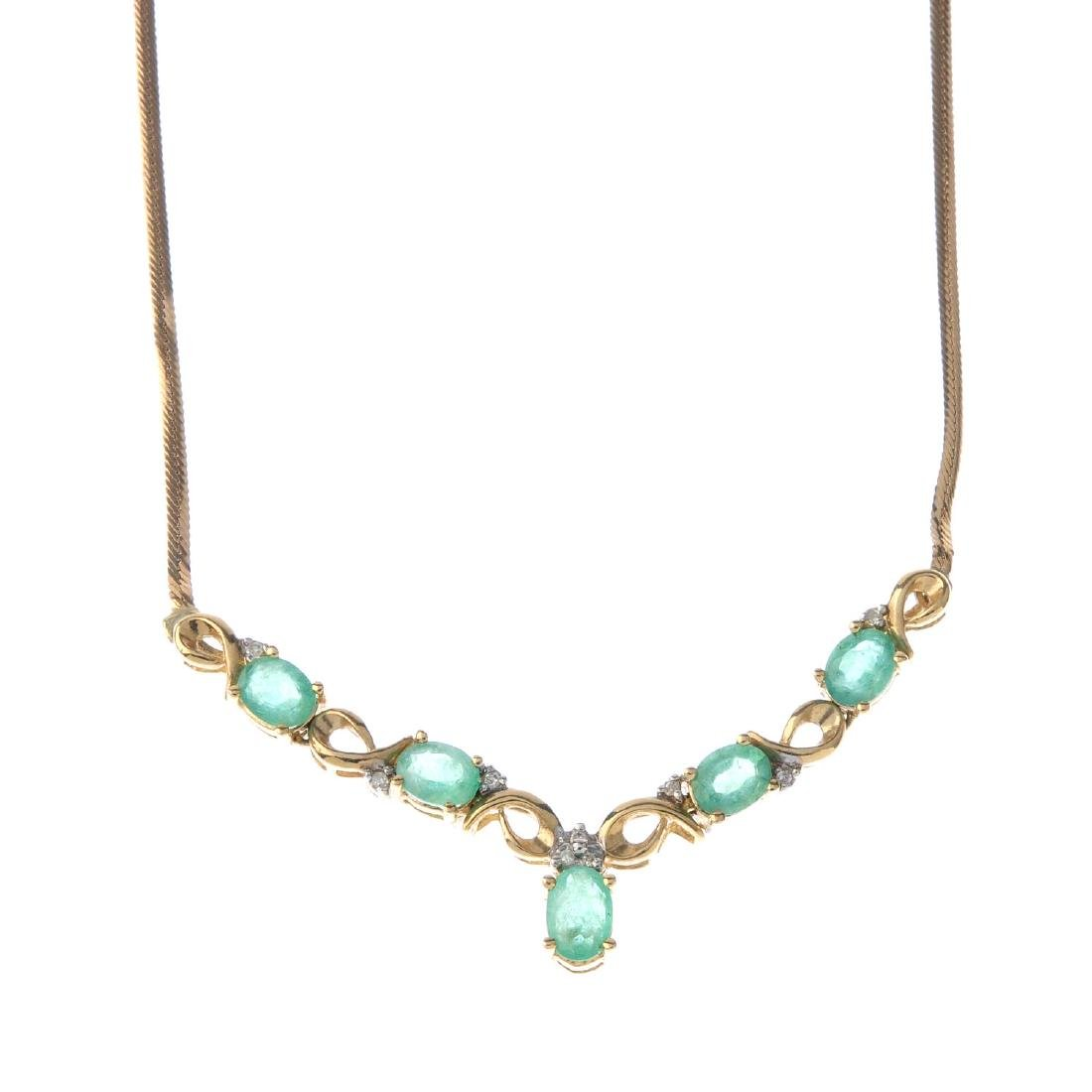 A 9ct gold emerald and diamond pendant. The oval-shape