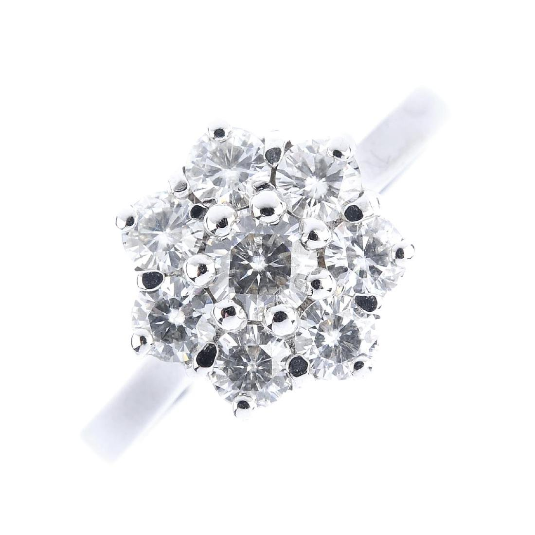 A 9ct gold diamond cluster ring. The brilliant-cut