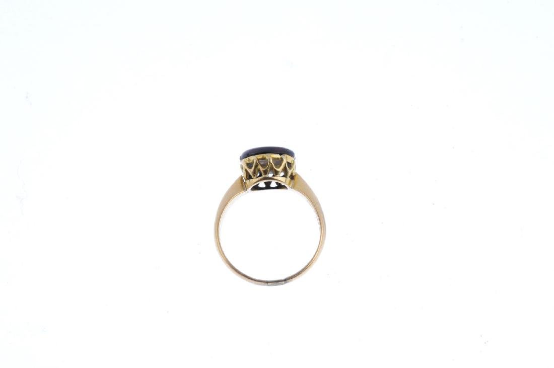 A garnet and diamond ring. Of circular outline, the - 2