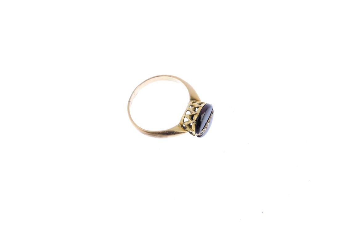 A garnet and diamond ring. Of circular outline, the - 3