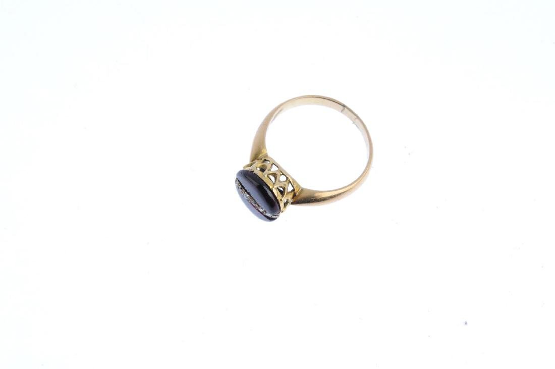 A garnet and diamond ring. Of circular outline, the - 4
