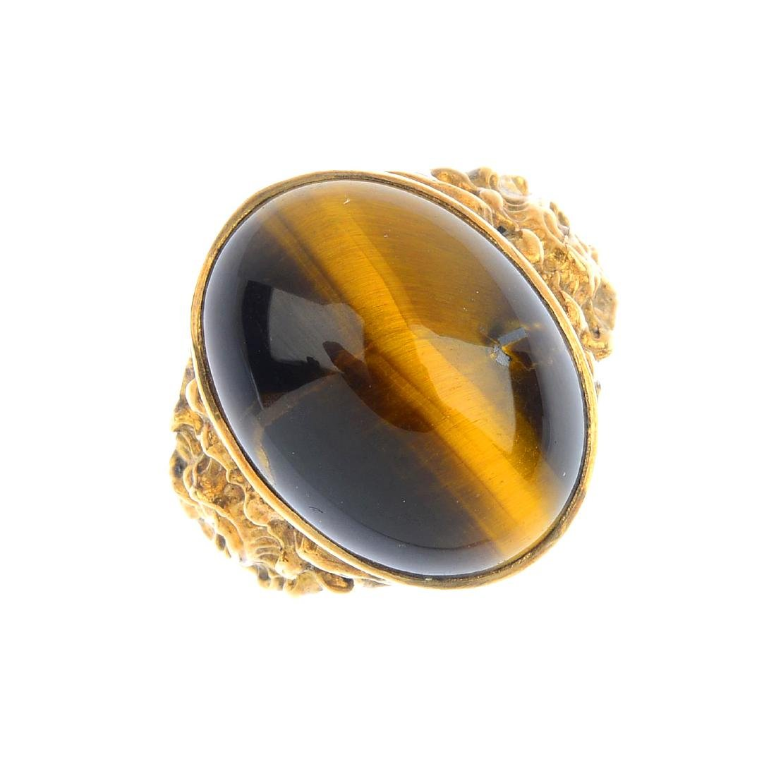 A tiger's-eye dress ring. The oval tiger's-eye