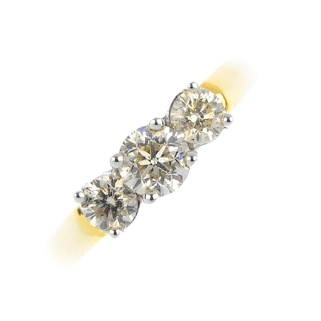 An 18ct gold diamond three-stone ring. The graduated