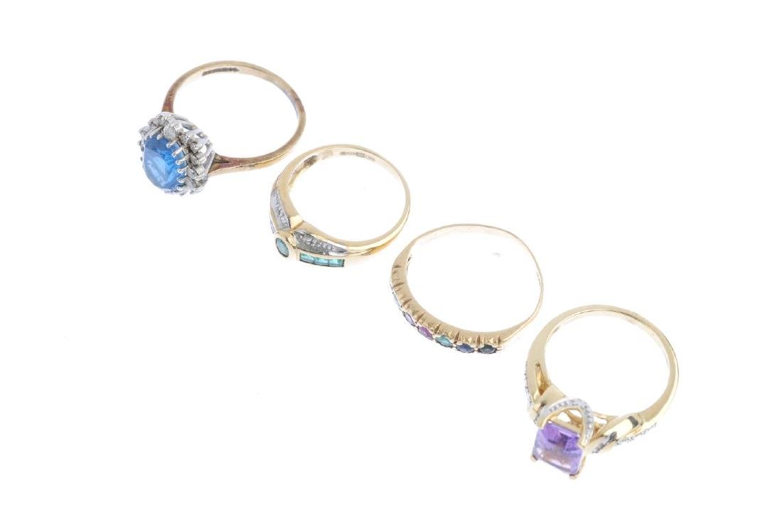 Four 9ct gold diamond and gem-set rings. To include a - 4