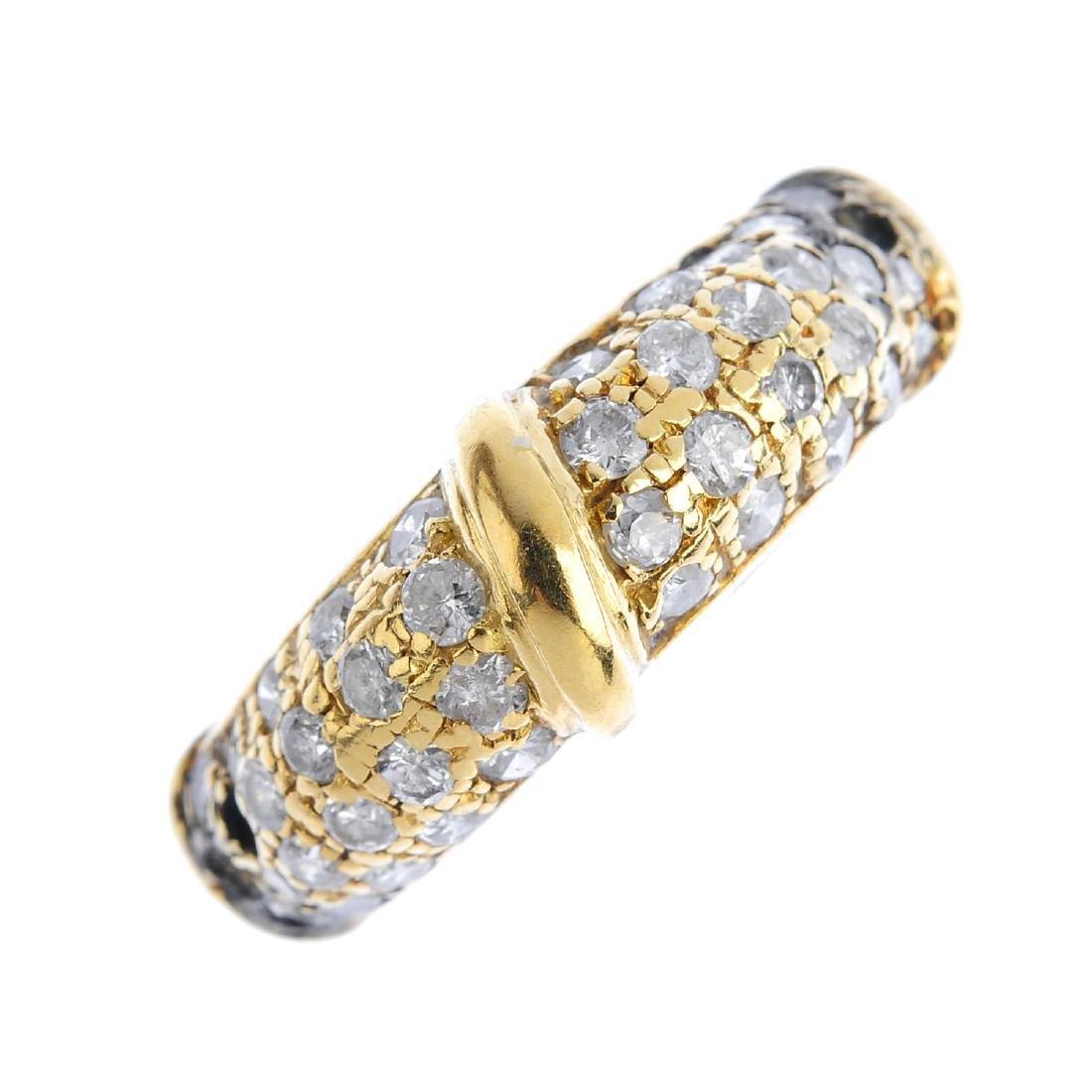 A diamond dress ring. The brilliant-cut diamond dome,
