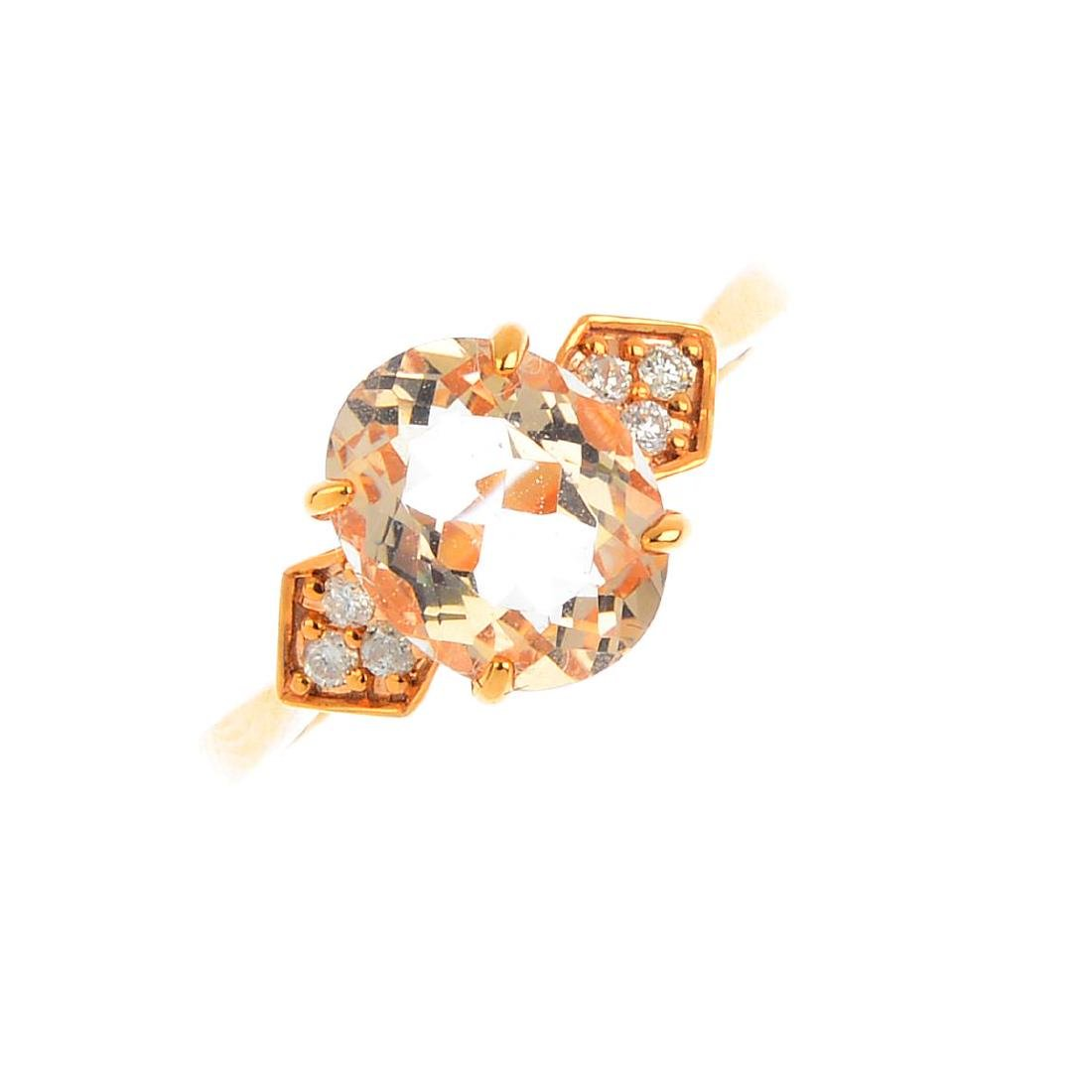 A morganite and diamond dress ring. The oval-shape